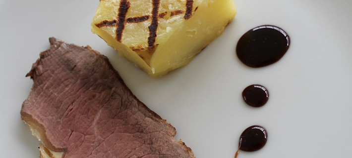 Photo of roast beef with fondant potato and balsamic reduction sauce